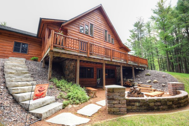 2 story stone natural FP (photo 1)