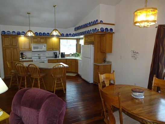 Dining area into kitchen (photo 5)