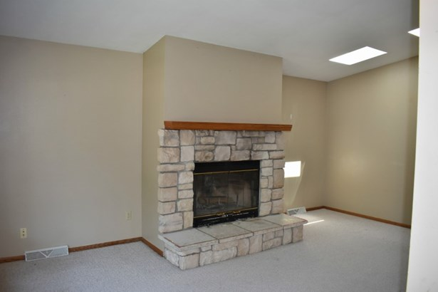 Fire place in living room (photo 2)