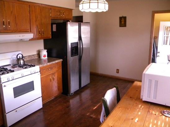 Kitchen to Liv Rm & Side Door (photo 3)