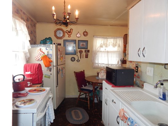Kitchen, from living room (photo 3)
