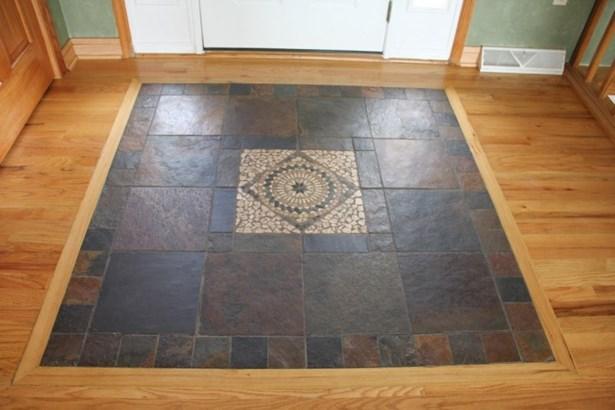 Tile inlay floor in Foyer (photo 4)