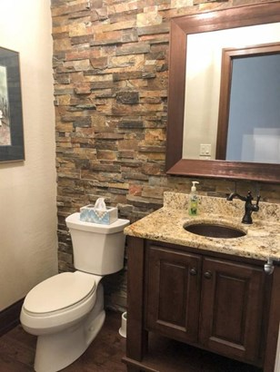 Half bath with stone accent wa (photo 2)