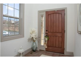 Open front entry with hardwood flooring (photo 3)