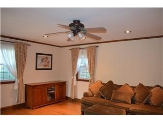 Living Room w/gleaming hardwood floors (photo 5)