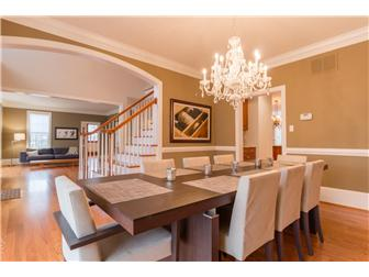 Formal dining room with chair rail & crown molding (photo 5)