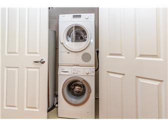 Laundry unit in foyer (photo 4)