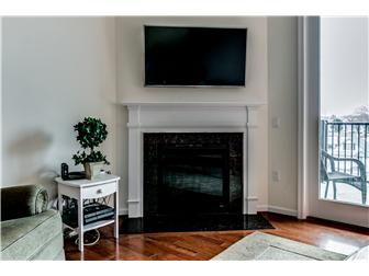Gas fireplace with sleek granite surround (photo 5)