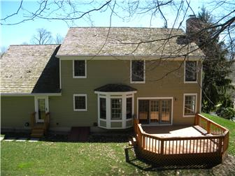 Private deck backs to wooded open space (photo 2)