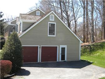 Side turned oversized two car garage w/ workspace (photo 4)
