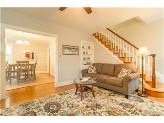 Gorgeous staircase leads to upper level. (photo 5)