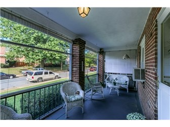 Inviting porch offers outside living space (photo 2)