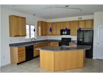 Kitchen with New Granite Countertops & Island (photo 4)