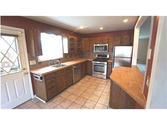 Spacious Kitchen w/Walkout to Yard (photo 3)