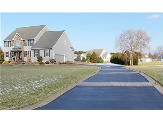 Lighted Driveway leading to 2 car Garage (photo 2)