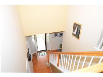 Beautiful open staircase overlooking foyer (photo 3)