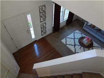 2-Story Foyer With Hardwood Floor (photo 3)