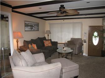 Living Room with beam ceiling and ceiling fan (photo 3)