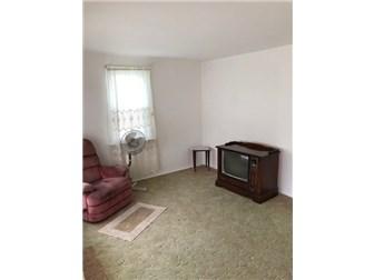 Living Rm, HW Floors under carpet (photo 4)