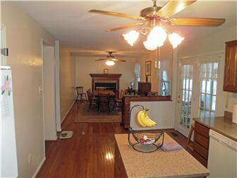 Wood floors in the kitchen w/ fan & island (photo 4)