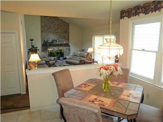 Eating area in kitchen opens to family room (photo 5)