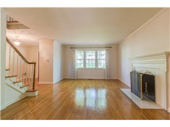 Spacious formal living room with brick fireplace (photo 5)