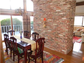 DINING RM. BRICK WALL TO CEILING (photo 3)
