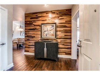Stunning wood paneled focal wall at foyer (photo 2)