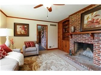 Living room has beautiful woods floors & fireplace (photo 2)