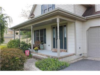 Front door and wraparound porch (photo 3)