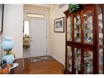 Entry hall hardwood flooring, high ceiling (photo 3)
