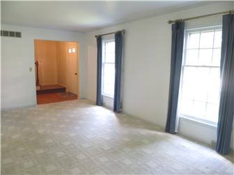 From the front entry into the spacious living room (photo 3)