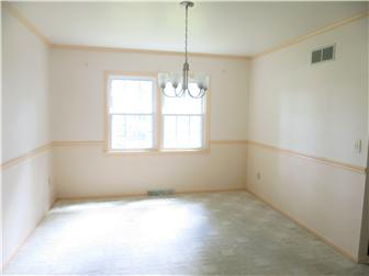 Dining room with chair rail and crown molding (photo 5)