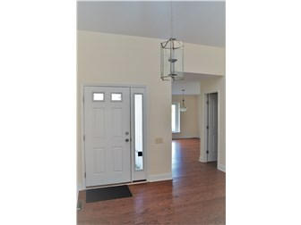 Bright & Inviting Foyer w Hardwood Floors (photo 2)