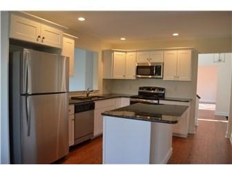 Granite Counters & White Cabinets (photo 5)