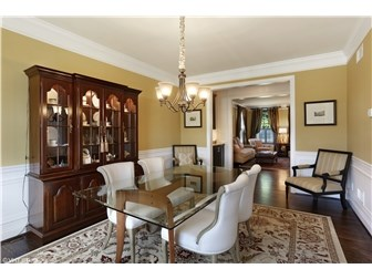 The formal dining room has wainscoting. (photo 5)