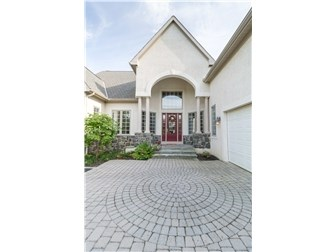 Spectacular entry with stone accents & paver walk (photo 2)