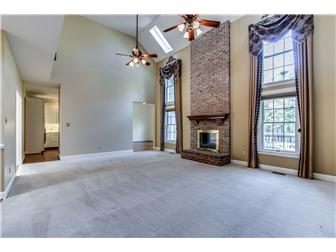 Two-Story Family Room with Brick Fireplace (photo 5)