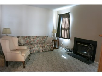 The cozy family room has a gas fireplace... (photo 4)