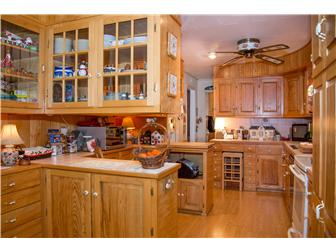 Nice kitchen with owner-built custom cabinets! (photo 4)