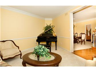 Formal living room at left of entry foyer (photo 4)