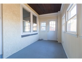 Fully enclosed front porch (photo 4)