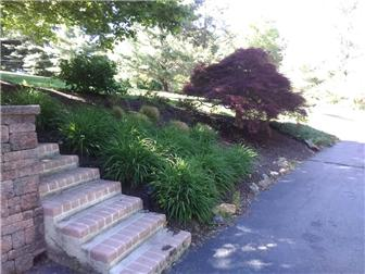 Additional landscaping with brick steps (photo 5)