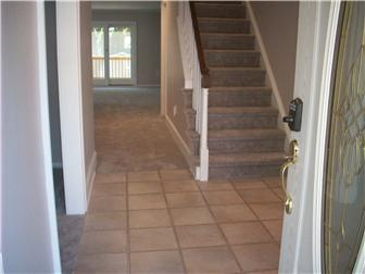 Wide Foyer Entry With Ceramic Tile Floor & Closet (photo 2)