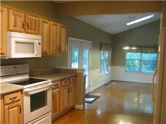 Updated Eat-In Kitchen w/ Raised Panel Cabinets (photo 2)