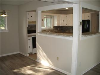 Open kitchen area to dining and living rooms (photo 5)
