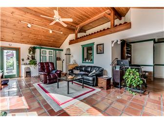 Soaring family room w hand made red tiles (photo 2)