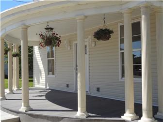 Inviting classical porch with fluted columns (photo 3)