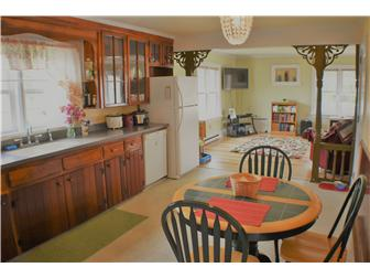 Eat-in kitchen opens to the family room (photo 4)