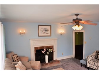 Wood burning fireplace with beautiful wall sconces (photo 3)